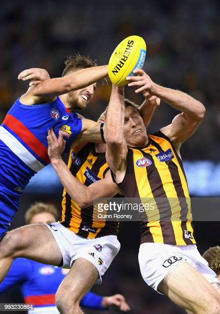 Ben McEvoy of the Hawks marks infront of Marcus Bontempelli of the Bulldogs during the round 16 AFL match between the Western Bulldogs and the...