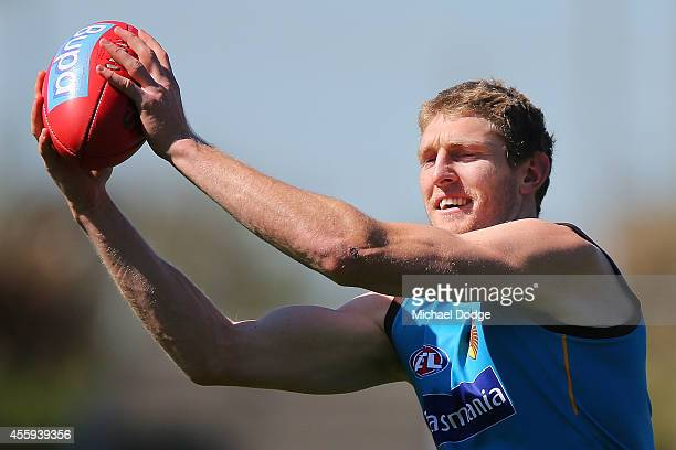 Ben McEvoy of the Hawks marks the ball during a Hawthorn Hawks AFL media session at Waverley Park on September 23, 2014 in Melbourne, Australia.
