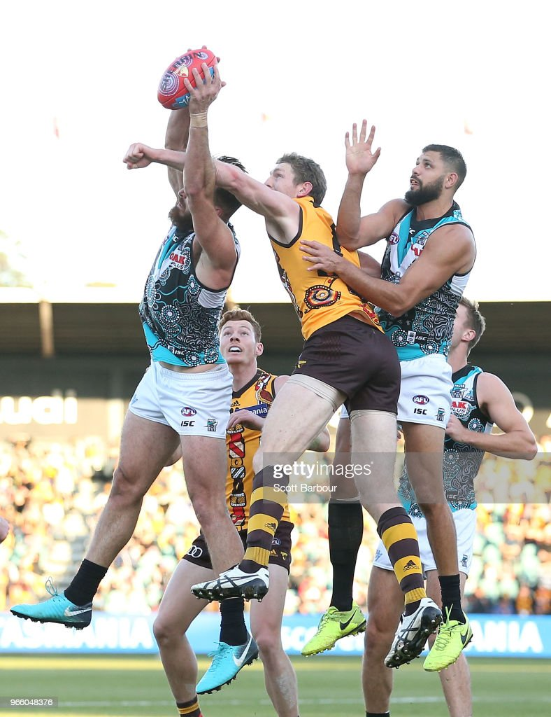Ben McEvoy of the Hawks, Paddy Ryder of the Power and Justin Westhoff of the Power compete for the ball during the round 11 AFL match between the Hawthorn Hawks and the Port Adelaide Power at University of Tasmania Stadium on June 2, 2018 in Launceston, Australia.