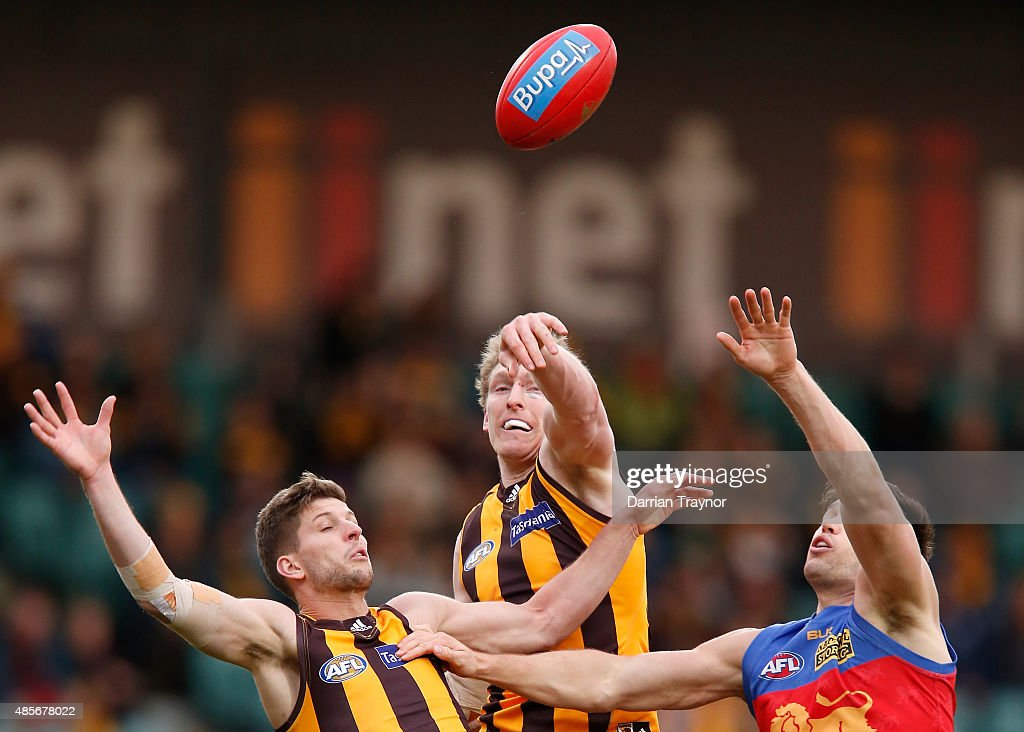 Ben McEvoy of the Hawks taps the ball clear of Stefan Martin of the Lions during the round 22 AFL match between the Hawthorn Hawks and the Brisbane Lions at Aurora Stadium on August 29, 2015 in Launceston, Australia.