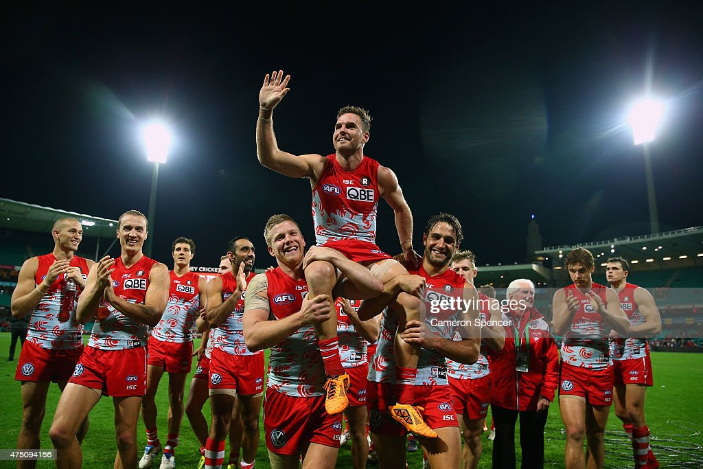 Ben McGlynn of the Swans is chaired off the field after playing his 150th game during the round nine AFL match between the Sydney Swans and the Carlton Blues at SCG on May 29, 2015 in Sydney, Australia.
