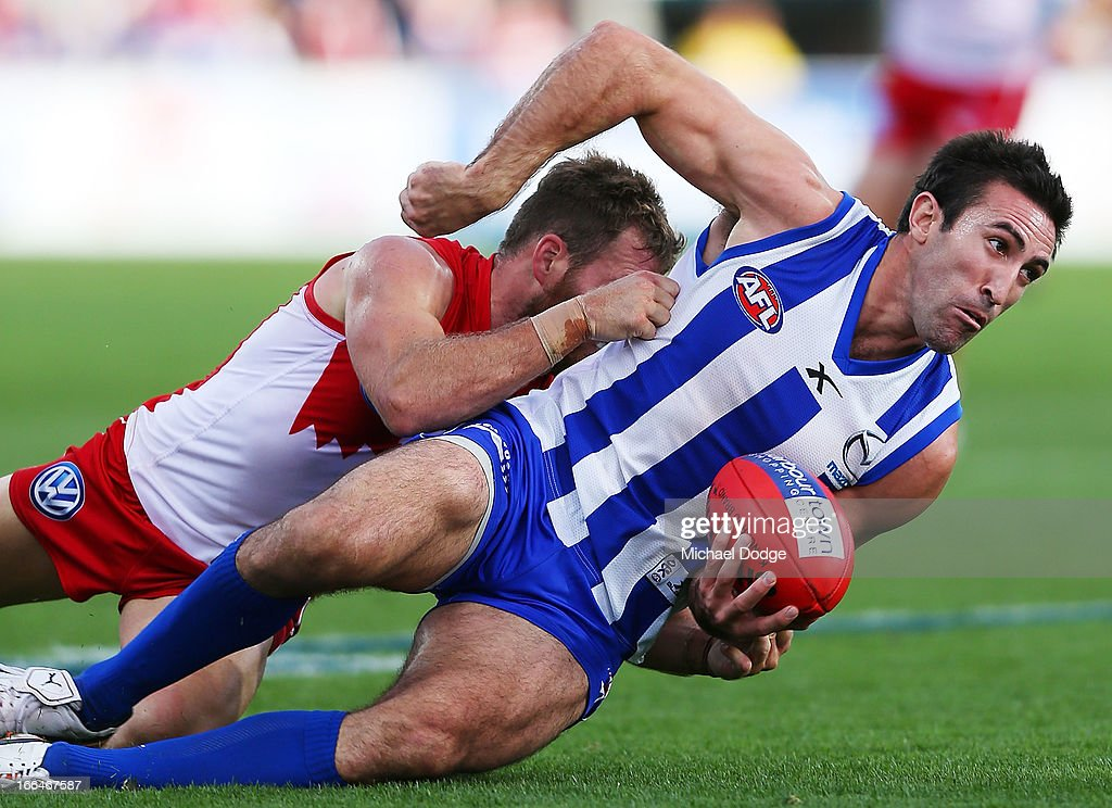 Ben McGlynn of the Swans tackles Michael Firrito of the Kangaroos during the round three AFL match between the North Melbourne Kangaroos and the Sydney Swans at Blundstone Arena on April 13, 2013 in Hobart, Australia.