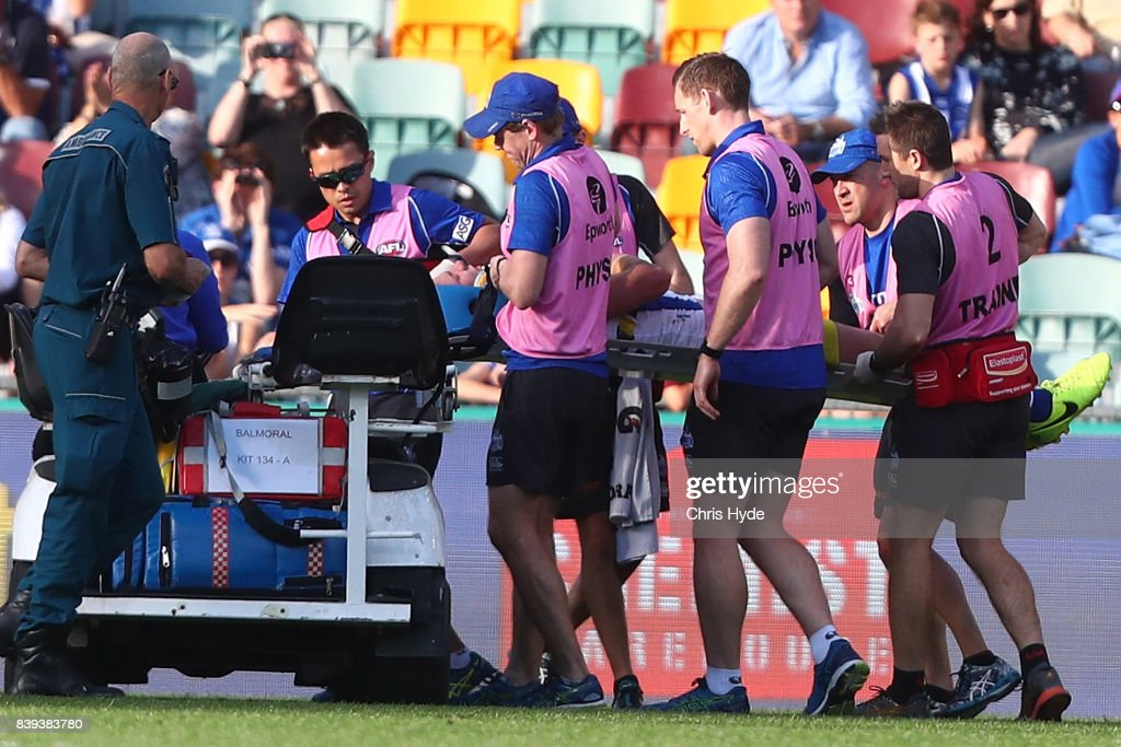 Ben McKay of the Kangaroos is stretchered from the field during the round 23 AFL match between the Brisbane Lions and the North Melbourne Kangaroos at The Gabba on August 26, 2017 in Brisbane, Australia.