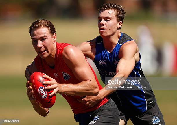 Ben McKay of the Kangaroos is tackled during a North Melbourne Kangaroos AFL training session at Arden Street on December 23 2016 in Melbourne...