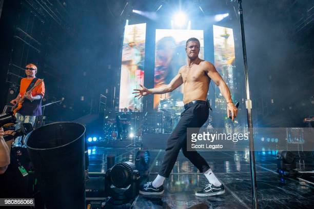 Ben McKee and Dan Reynolds of Imagine Dragons perform during their Evolve World Tour 2018 at DTE Energy Music Theater on June 21 2018 in Clarkston...