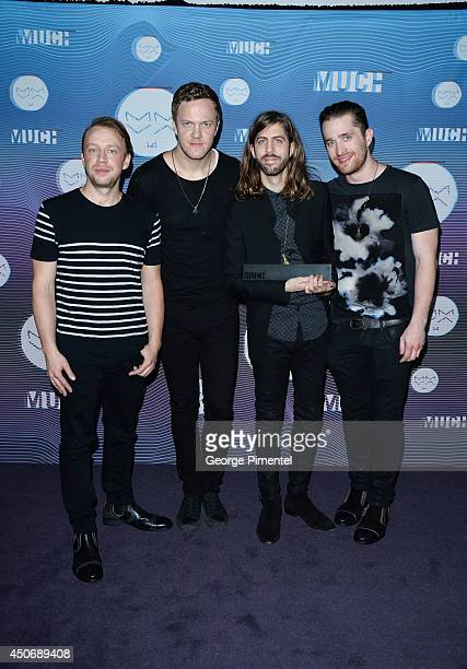 Ben McKee Dan Reynolds Wayne Sermon and Daniel Platzman of Imagine Dragons pose in the press room at the 2014 MuchMusic Video Awards at MuchMusic HQ...