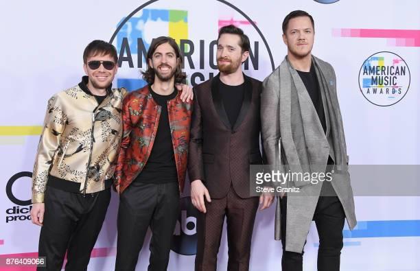 Ben McKee Daniel Wayne Sermon Daniel Platzman and Dan Reynolds of Imagine Dragons attend the 2017 American Music Awards at Microsoft Theater on...