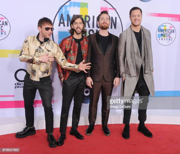 Ben McKee Daniel Wayne Sermon Daniel Platzman and Dan Reynolds of Imagine Dragons arrive at the 2017 American Music Awards at Microsoft Theater on...