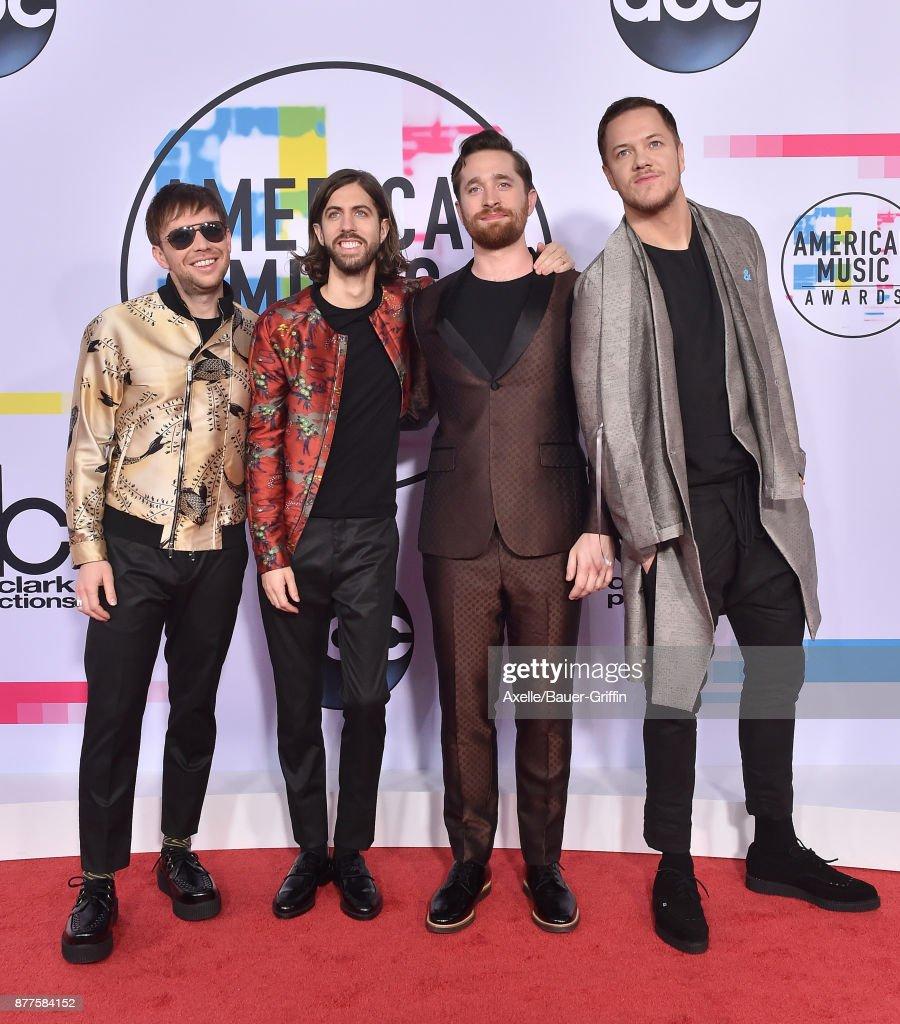 Ben McKee, Daniel Wayne Sermon, Daniel Platzman and Dan Reynolds of Imagine Dragons arrive at the 2017 American Music Awards at Microsoft Theater on November 19, 2017 in Los Angeles, California.