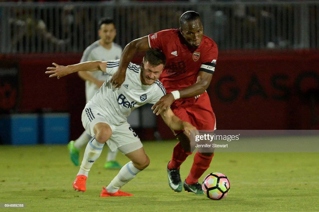 Ben McKendry #30 of Vancouver Whitecaps II and Didier Drogba #11 of Phoenix Rising FC battle for the ball in the second half of the match at Phoenix Rising Soccer Complex on June 10, 2017 in Phoenix, Arizona. The Phoenix Rising FC won 2-1.