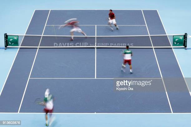 Ben McLachlan and Yasutaka Uchiyama of Japan play against Fabio Fognini and Simone Bolelli of Italy during their doubles match during day two of the...