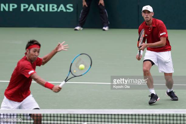 Ben McLachlan and Yasutaka Uchiyama of Japan play in their doubles match against Tomislav Brkic and Nerman Fatic of Bosnia and Herzegovina during day...