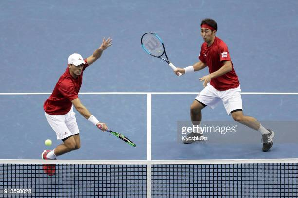 Ben McLachlan and Yasutaka Uchiyama of Japan play in their doubles match against Simone Bolelli and Fabio Fognini of Italy during day two of the...