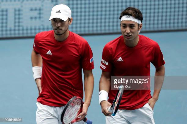 Ben McLachlan and Yasutaka Uchiyama of Japan react while playing in their doubles match against Gonzalo Escobar and Diego Hidalgo of Ecuador on day...