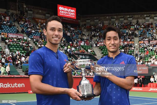 Ben McLachlan of Japan and doubles partner Yasutaka Uchiyama of Japan pose with the winners trophy after their men's doubles final match against...