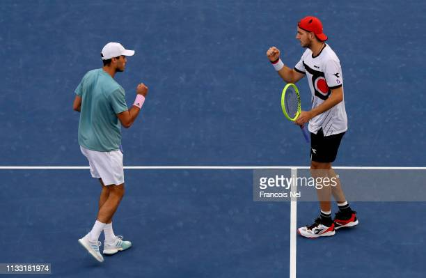 Ben McLachlan of Japan and JanLennard Struff of Germany celebrate in their Men's Doubles Final match against Rajeev Ram of the United States and Joe...