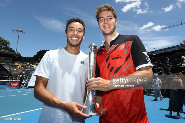 Ben McLachlan of Japan and JanLennard Struff of Germany celebrate with the trophy after winning the Mens Doubles final against Michael Venus of New...