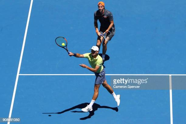 Ben McLachlan of Japan and JanLennard Struff of Germany compete in their fourth round men's doubles match against Lukasz Kubot of Poland and Marcelo...
