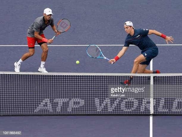 Ben Mclachlan of Japan and JanLennard Struff of Germany in action against Ben Raven Klaasen of Republic of South Africa and Michael Venus of New...