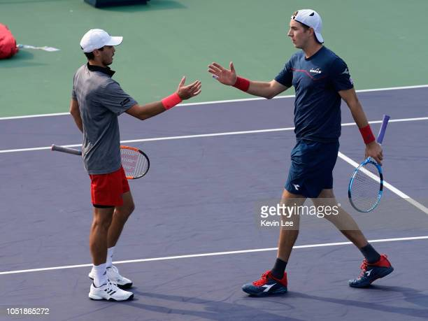 Ben Mclachlan of Japan and JanLennard Struff of Germany shakes hand to each other after losing defeating by Ben Raven Klaasen of Republic of South...