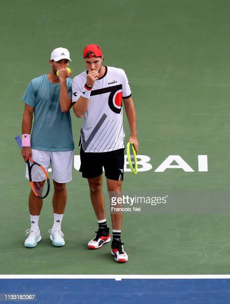 Ben McLachlan of Japan and JanLennard Struff of Germany talk tactics in in their Men's Doubles Final match against Rajeev Ram of the United States...