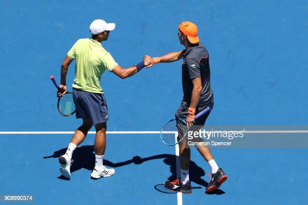 Ben McLachlan of Japan and JanLennard Struff of Germany talk tactics in their fourth round men's doubles match against Lukasz Kubot of Poland and...