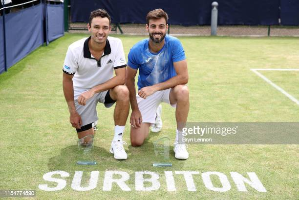Ben McLachlan of Japan and Marcel Granollers of Spain pose with their trophies after winning the Men's Doubles Final on day seven of the Surbiton...