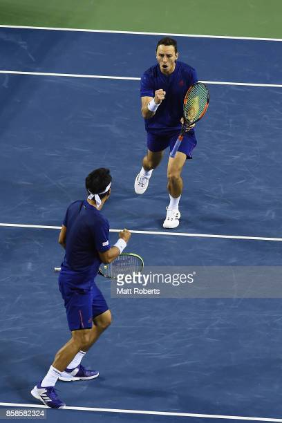 Ben McLachlan of Japan and Yasutaka Uchiyama of Japan celebrate during their men's doubles semi final match against Santiago Gonzalez of Mexico and...
