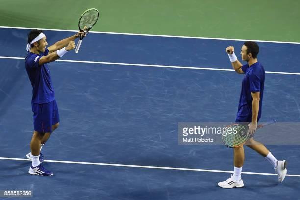 Ben McLachlan of Japan and Yasutaka Uchiyama of Japan celebrate winning their men's doubles semi final match against Santiago Gonzalez of Mexico and...