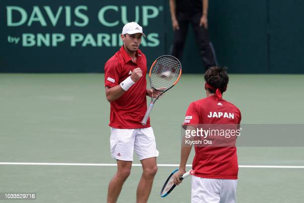 Ben McLachlan of Japan celebrates a point with Yasutaka Uchiyama of Japan in their doubles match against Tomislav Brkic and Nerman Fatic of Bosnia...