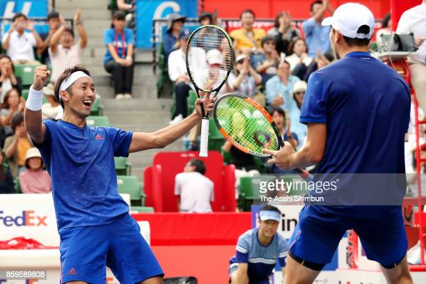 Ben McLachlan of Japan celebrates victory with doubles partner Yasutaka Uchiyama of Japan in their men's doubles final match against Jamie Murray of...