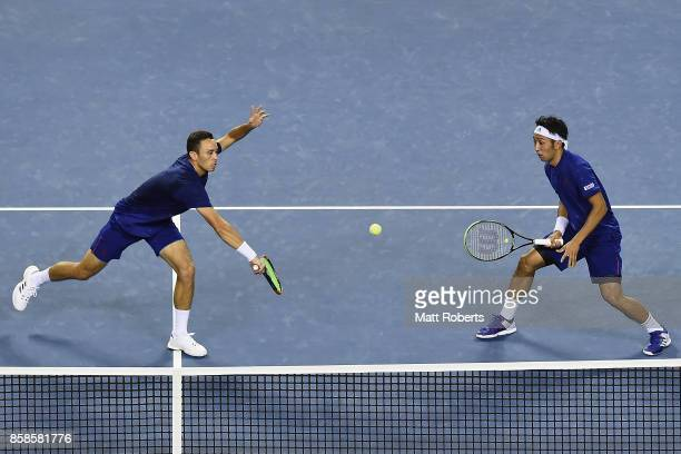 Ben McLachlan of Japan plays a backhand with doubles partner Yasutaka Uchiyama of Japan in the men's doubles semi final match against Santiago...
