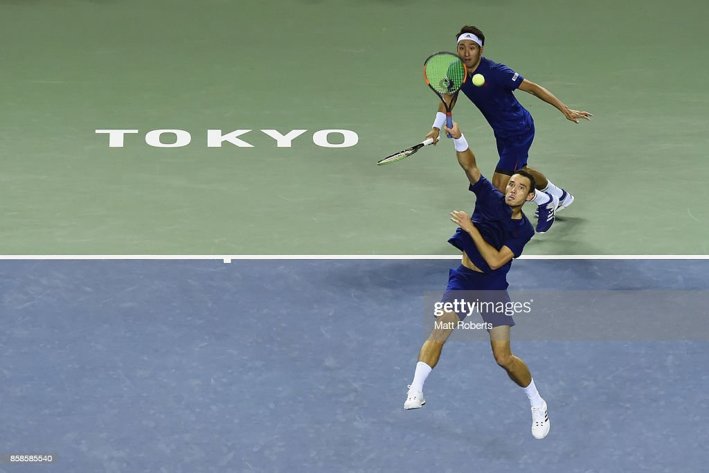 Ben McLachlan of Japan plays a overhead volley with doubles partner Yasutaka Uchiyama of Japan in the men's doubles semi final match against Santiago Gonzalez of Mexico and Julio Peralta of Chile during day six of the Rakuten Open at Ariake Coliseum on October 7, 2017 in Tokyo, Japan.