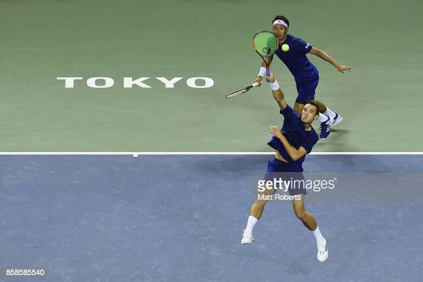 Ben McLachlan of Japan plays a overhead volley with doubles partner Yasutaka Uchiyama of Japan in the men's doubles semi final match against Santiago...