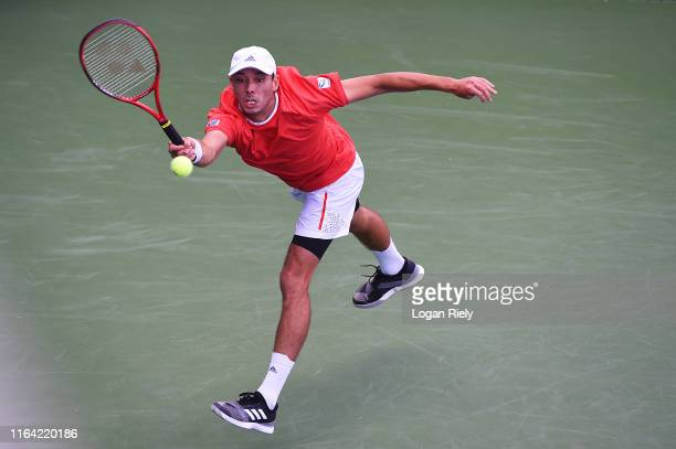 Ben McLachlan of Japan returns a forehand to Jack Sock and Jackson Withrow during the BBT Atlanta Open at Atlantic Station on July 25 2019 in Atlanta...