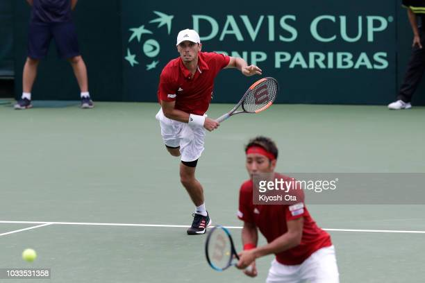 Ben McLachlan of Japan serves as he plays with Yasutaka Uchiyama of Japan in their doubles match against Tomislav Brkic and Nerman Fatic of Bosnia...