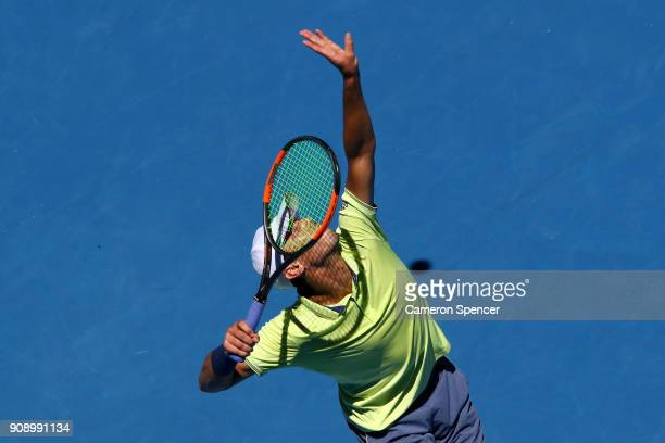 Ben McLachlan of Japan serves in his fourth round men's doubles match with JanLennard Struff of Germany against Lukasz Kubot of Poland and Marcelo...