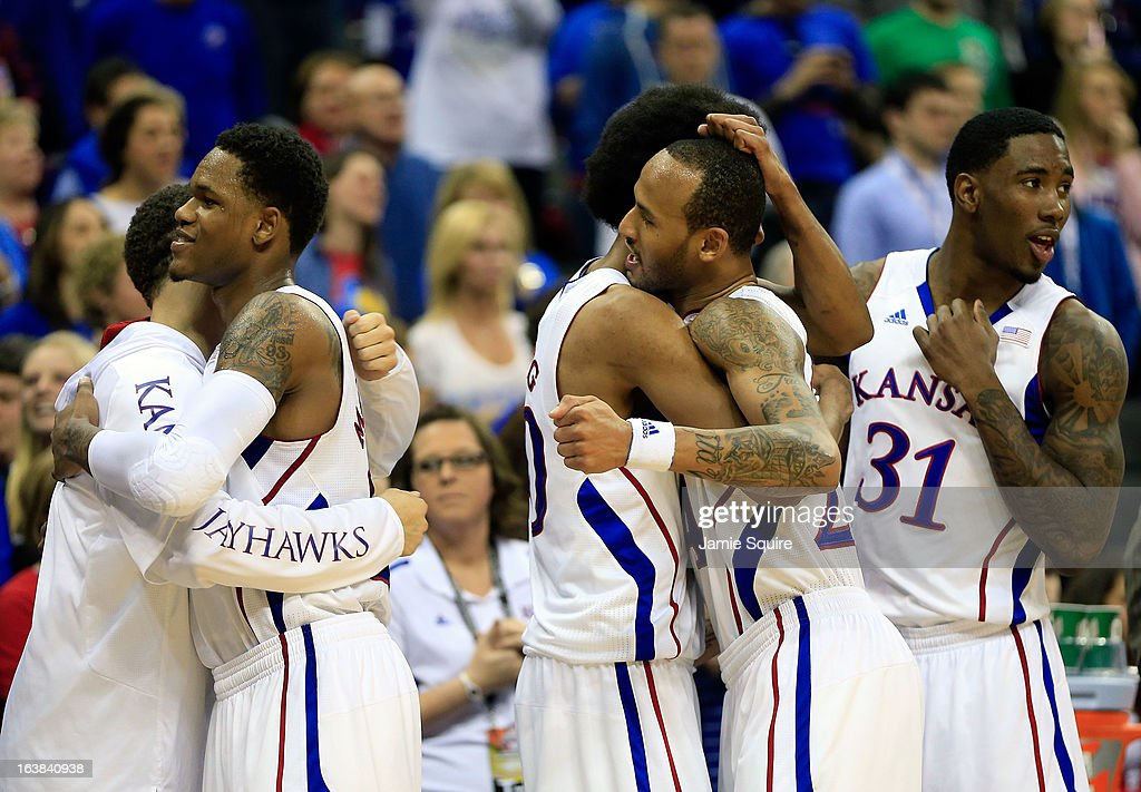 Ben McLemore #23, Kevin Young #40, Travis Releford #24 and Jamari Traylor #31 of the Kansas Jayhawks celebrate their 70-54 win over Kansas State Wildcats during the Final of the Big 12 basketball tournament at Sprint Center on March 16, 2013 in Kansas City, Missouri.