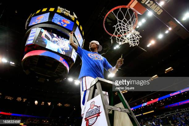Ben McLemore of the Kansas Jayhawks cuts the net in celebration of their 7054 victory over the Kansas State Wildcats during the Final of the Big 12...