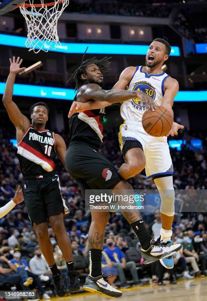 Ben McLemore of the Portland Trail Blazers slaps the ball away from Stephen Curry of the Golden State Warriors during the second half of their game...