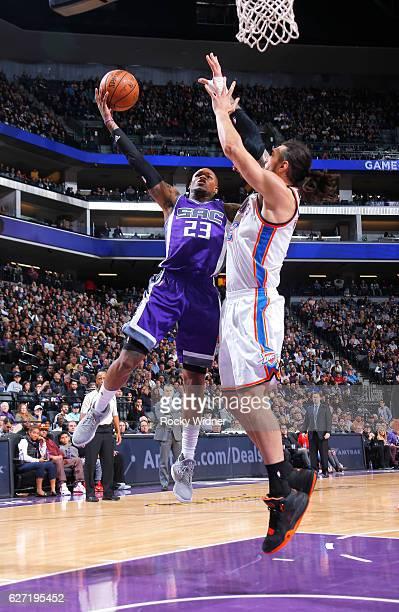 Ben McLemore of the Sacramento Kings goes up for the shot against Steven Adams of the Oklahoma City Thunder on November 23 2016 at Golden 1 Center in...