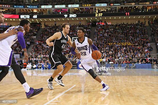 Ben McLemore of the Sacramento Kings handles the ball against Bojan Bogdanovic of the Brooklyn Nets during the 2014 NBA Global Games at the...