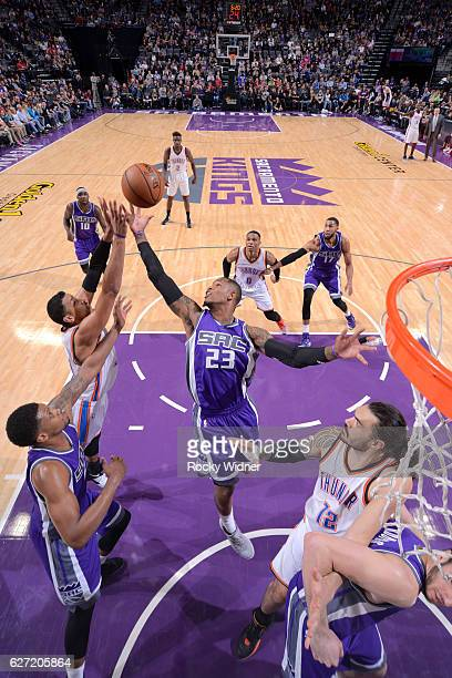 Ben McLemore of the Sacramento Kings rebounds against Andre Roberson of the Oklahoma City Thunder on November 23 2016 at Golden 1 Center in...