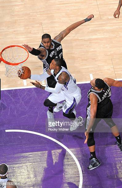 Ben McLemore of the Sacramento Kings shoots a layup against LaMarcus Aldridge of the San Antonio Spurs on November 9 2015 at Sleep Train Arena in...