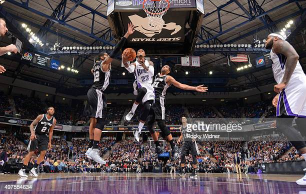Ben McLemore of the Sacramento Kings shoots a layup against LaMarcus Aldridge and Tim Duncan of the San Antonio Spurs on November 9 2015 at Sleep...