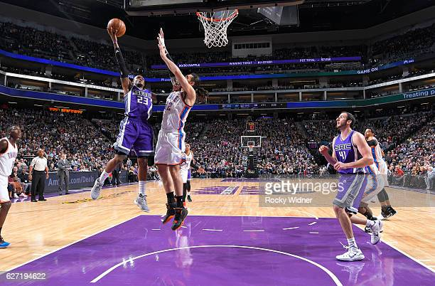 Ben McLemore of the Sacramento Kings shoots a layup against Steven Adams of the Oklahoma City Thunder on November 23 2016 at Golden 1 Center in...