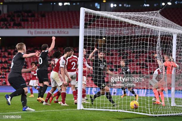 Ben Mee, Ashley Barnes and James Tarkowski of Burnley celebrate as Pierre-Emerick Aubameyang of Arsenal scores an own goal during the Premier League...
