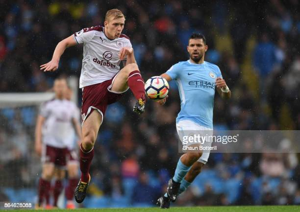 Ben Mee of Burnley beats Sergio Aguero of Manchester City to the ball during the Premier League match between Manchester City and Burnley at Etihad...