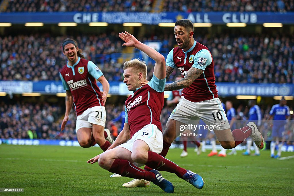 Ben Mee (C) of Burnley celebrates after scoring a goal to level the scores at 1-1 during the Barclays Premier League match between Chelsea and Burnley at Stamford Bridge on February 21, 2015 in London, England.