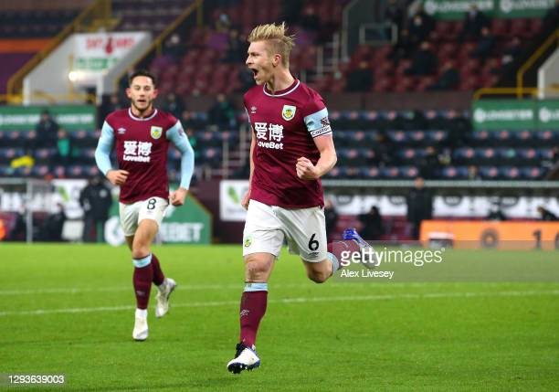 Ben Mee of Burnley celebrates after scoring their team's first goal during the Premier League match between Burnley and Sheffield United at Turf Moor...